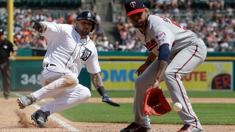Detroit Tigers' Nicholas Castellanos safely beats the relay from Minnesota Twins catcher Chris Gimenez to starting pitcher Ervin Santana to score during the fifth inning of a baseball game, Sunday, Aug. 13, 2017, in Detroit. (AP Photo/Carlos Osorio)