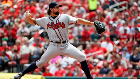 Atlanta Braves starting pitcher R.A. Dickey throws during the first inning of a baseball game against the St. Louis Cardinals, Sunday, Aug. 13, 2017, in St. Louis. (AP Photo/Jeff Roberson)