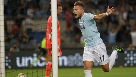Lazio's Ciro Immobile celebrates after scoring during the Italian Super Cup final match between Lazio and Juventus at Rome's Olympic stadium, Sunday, Aug. 13, 2017. (AP Photo/Gregorio Borgia)