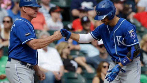 Kansas City Royals' Whit Merrifield, right, celebrates with third base coach Mike Jirschele after hitting a two-RBI triple against the Chicago White Sox during the sixth inning of a baseball game Sunday, Aug. 13, 2017, in Chicago. (AP Photo/Nam Y. Huh)