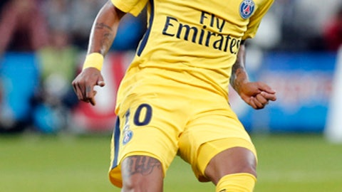 PSG's Neymar kicks the ball to make a pass during the French League One soccer match between Guingamp and PSG at the Roudourou stadium in Guingamp, western France, Sunday, Aug. 13, 2017. Neymar makes his long-awaited debut with Paris Saint-Germain on Sunday in the small Brittany town of Guingamp. (AP Photo/Kamil Zihnioglu)