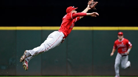 Los Angeles Angels shortstop Andrelton Simmons stretches as he snags a line drive by Seattle Mariners' Jean Segura in the first inning of a baseball game Sunday, Aug. 13, 2017, in Seattle. (AP Photo/Elaine Thompson)