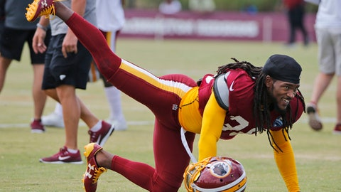 FILE - This Aug. 1, 2017 file photo shows Washington Redskins free safety D.J. Swearinger (36) stretching during practice at the Washington Redskins NFL training camp in Richmond, Va. The Redskins are hoping Swearinger is the answer at their free safety position. The team signed the 25 year old in the offseason and also gained a very vocal leader. Swearinger celebrates each defensive stand the defense makes, even in practice, and says he views it as his job to keep energy levels high. (AP Photo/Steve Helber, file)