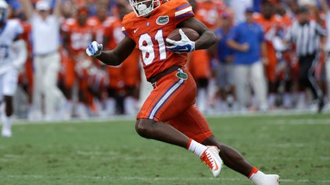 FILE - This Sept. 10, 2016 file photo shows Florida wide receiver Antonio Callaway (81) running after a reception against Kentucky in the first half of an NCAA college football game in Gainesville, Fla. Florida has suspended Callaway and six others for the team's season opener against Michigan. A person familiar with the situation tells The Associated Press the players were suspended for misusing school-issued funds. The person spoke to the AP on the condition of anonymity Sunday, Aug. 13, 2017 because Florida did not release details of the suspensions. (AP Photo/John Raoux)