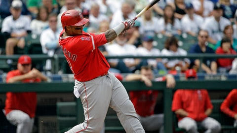 Los Angeles Angels' Martin Maldonado singles in a pair of runs against the Seattle Mariners in the fifth inning of a baseball game, Sunday, Aug. 13, 2017, in Seattle. (AP Photo/Elaine Thompson)