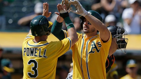 Oakland Athletics' Matt Joyce, right, celebrates with Boog Powell (3) after hitting a two run home run against the Baltimore Orioles in the seventh inning of a baseball game Sunday, Aug. 13, 2017, in Oakland, Calif. (AP Photo/Ben Margot)