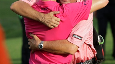Justin Thomas, left, hugs his dad Mike after the final round of the PGA Championship golf tournament at the Quail Hollow Club Sunday, Aug. 13, 2017, in Charlotte, N.C. (AP Photo/John Bazemore)