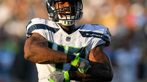 Seattle Seahawks defensive end David Bass reacts after a sack during the first half of an NFL preseason football game against the Los Angeles Chargers, Sunday, Aug. 13, 2017, in Carson, Calif. (AP Photo/Mark J. Terrill)