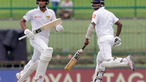 Sri Lanka's captain Dinesh Chandimal, left, and Angelo Mathews run between the wickets during the third day's play of their third cricket test match against India in Pallekele, Sri Lanka, Monday, Aug. 14, 2017. (AP Photo/Eranga Jayawardena)