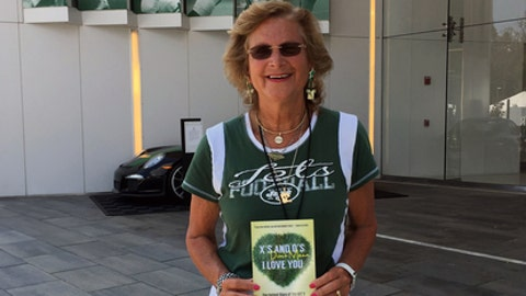"Former New York Jets scout Connie Carberg poses outside the Jets practice facility in Florham Park, N.J., Wednesday, Aug. 9, 2017. Her journey from Jets team secretary to watching game films, traveling and scouting college players is the subject of a recently published book: ""X's And O's Don't Mean I Love You."" How she helped deliver the sack-dancing Gastineau to the Jets is just one of the many fascinating behind-the-scenes tales told by Carberg and author Elisabeth Meinecke. (AP Photo/Dennis Waszak)"