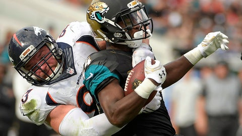 FILE - In this Dec. 4, 2016, file photo, Jacksonville Jaguars running back T.J. Yeldon, right, is stopped by Denver Broncos defensive end Jared Crick during the first half of an NFL football game in Jacksonville, Fla. Crick is the latest victim of the Broncos' injury outbreak. He was carted off the practice field Monday, Aug, 14, 2017, with what coach Vance Joseph said were thought to be back spasms. (AP Photo/Phelan M. Ebenhack, File)