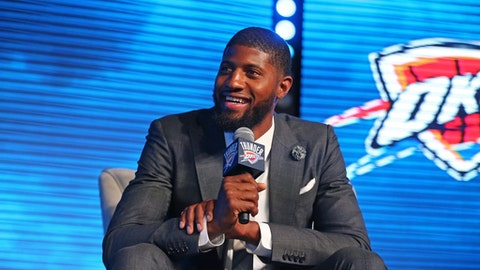 OKLAHOMA CITY, OK - JULY 12:  Paul George #13 of the Oklahoma City Thunder speaks to fans and media during a media event on July 12, 2017 at the Jones Assembly Hall in Oklahoma City, Oklahoma. NOTE TO USER: User expressly acknowledges and agrees that, by downloading and or using this Photograph, user is consenting to the terms and conditions of the Getty Images License Agreement. Mandatory Copyright Notice: Copyright 2017 NBAE (Photo by Layne Murdoch/NBAE via Getty Images)