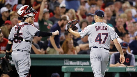 Cleveland Indians starting pitcher Trevor Bauer (47) is congratulated by catcher Roberto Perez after striking out Boston Red Sox's Brock Holt with two on base during the sixth inning of a baseball game in Boston, Monday, Aug. 14, 2017. (AP Photo/Charles Krupa)
