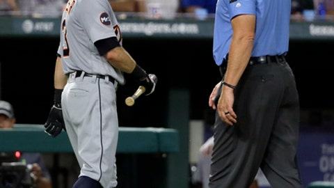 Detroit Tigers' Ian Kinsler, left, argues with crew chief Ted Barrett, right, after Kinsler was ejected by home plate umpire Angel Hernandez in the fifth inning of a baseball game against the Texas Rangers on Monday, Aug. 14, 2017, in Arlington, Texas. (AP Photo/Tony Gutierrez)