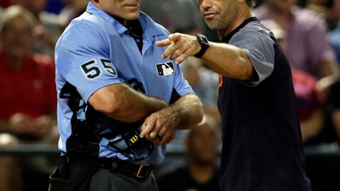 Home plate umpire Angel Hernandez (55) listens as Detroit Tigers manager Brad Ausmus, right, argues with Hernandez after Ian Kinsler was ejected in the fifth inning of a baseball game against the Texas Rangers on Monday, Aug. 14, 2017, in Arlington, Texas. Ausmus was ejected by Hernandez during the argument. (AP Photo/Tony Gutierrez)