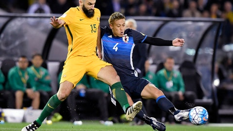 In this file photo from Oct. 11, 2016, Australia's Mile Jedinak, left, and Japan's Keisuke Honda contest for the ball during their World Cup qualifying match in Melbourne, Australia, Tuesday, Oct. 11, 2016. Socceroos skipper Jedinak has been recalled to Australia's squad for a pair of crucial World Cup qualifiers against Japan and Thailand.(AP Photo/Andy Brownbill, File)