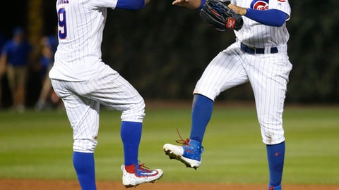 Chicago Cubs' Javier Baez, left, and Jon Jay celebrate the Cubs' 15-5 win over the Cincinnati Reds after a baseball game Monday, Aug. 14, 2017, in Chicago. (AP Photo/Charles Rex Arbogast)