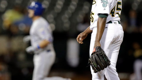 Oakland Athletics' Jharel Cotton, right, waits for Kansas City Royals' Cam Gallagher, left, to run the bases after hitting a grand slam in the sixth inning of a baseball game Monday, Aug. 14, 2017, in Oakland, Calif. (AP Photo/Ben Margot)