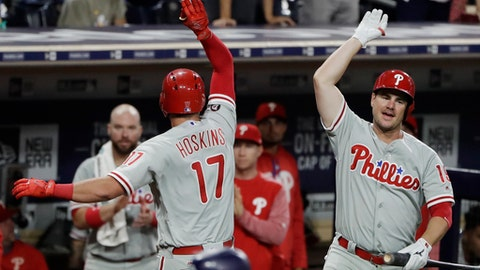 Philadelphia Phillies' Rhys Hoskins (17) celebrates with teammate Tommy Joseph, right, after hitting his second home run of the night during the seventh inning of a baseball game against the San Diego Padres Monday, Aug. 14, 2017, in San Diego. (AP Photo/Gregory Bull)