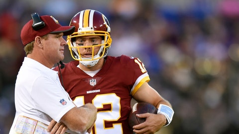 FILE - In this Aug. 10, 2017, file photo, Washington Redskins head coach Jay Gruden, left, speaks with quarterback Colt McCoy in the first half of a preseason NFL football game against the Baltimore Ravens, in Baltimore. With apologies to quarterback-turned-wide receiver Terrelle Pryor Sr. and slot man Jamison Crowdwer, the most important member of the Redskins offense could easily become backup quarterback Colt McCoy. The veteran is in his eighth season, and one play away from having the Redskins' fortunes in his hands. (AP Photo/Gail Burton, File)