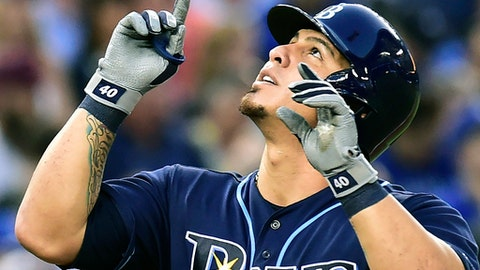 Tampa Bay Rays catcher Wilson Ramos (40) celebrates after hitting a solo home run against the Toronto Blue Jays during the fourth inning of a baseball game, Tuesday, Aug. 15, 2017 in Toronto. (Frank Gunn/The Canadian Press via AP)