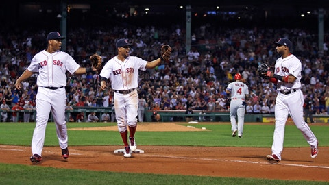 From left, Boston Red Sox third baseman Rafael Devers, shortstop Xander Bogaerts and second baseman Eduardo Nunez, celebrate after turning a triple play on a ground out by St. Louis Cardinals' Yadier Molina (4) during the fourth inning of a baseball game in Boston, Tuesday, Aug. 15, 2017. (AP Photo/Charles Krupa)