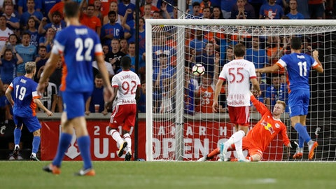 FC Cincinnati midfielder Corben Bone (19) scores on New York Red Bulls goalkeeper Ryan Meara, second from right, in the first half of a U.S. Open Cup soccer semi-final match, Tuesday, Aug. 15, 2017, in Cincinnati. (AP Photo/John Minchillo)