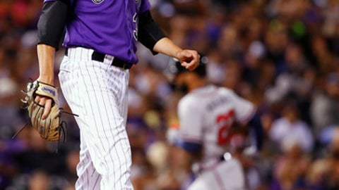 Colorado Rockies starting pitcher Kyle Freeland hangs his head as Atlanta Braves' Nick Markakis rounds the bases after hitting a solo home run during the sixth inning of a baseball game Tuesday, Aug. 15, 2017, in Denver. (AP Photo/Jack Dempsey)