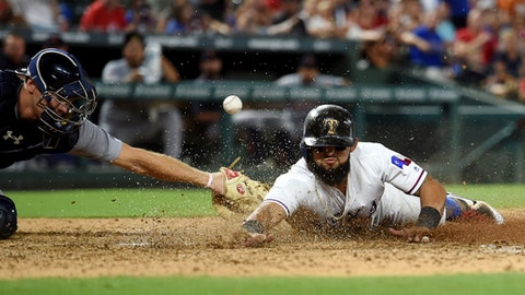Texas Rangers second baseman Rougned Odor (12) steals home ahead of the tag of Detroit Tigers catcher John Hicks in the seventh inning of a baseball game, Tuesday, Aug. 15, 2017, in Arlington, Texas. (AP Photo/Jeffrey McWhorter)