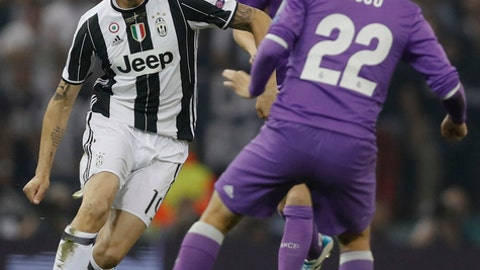 FILE - In this Saturday June 3, 2017 file photo, Juventus' Leonardo Bonucci, left, challenges for the ball with Real Madrid's Isco during the Champions League final soccer match at the Millennium Stadium in Cardiff, Wales. Considered Italy's top defender _ which is saying a lot for a nation that prides itself on its defenders _ Bonucci's transfer from Juventus to AC Milan could alter the balance of power in Serie A. While Bonucci clashed often with Juventus coach Massimiliano Allegri last season, his decision to leave the six-time defending champion was still surprising.(AP Photo/Kirsty Wigglesworth)