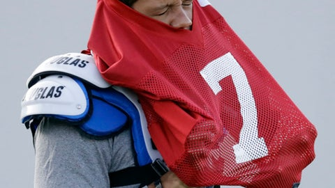 Indianapolis Colts quarterback Stephen Morris puts on his jersey during practice at the NFL team's football training camp Wednesday, Aug. 16, 2017, in Indianapolis. (AP Photo/Darron Cummings)