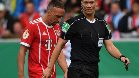 FILE - In this Aug. 12, 2017 file photo Munich's Franck Ribery and referee Bibiana Steinhaus walk on the pitch during the German Soccer Cup first-round soccer match between Chemnitzer FC and FC Bayern Munich in Chemnitz, Germany. Carving her way in a man's world, Bibiana Steinhaus is striking a blow for equality as the Bundesliga's first female referee this season. The 38-year-old police officer, who has been refereeing in the second division since 2007, is one of four referees promoted by the German football federation (DFB) to the top flight.  (Hendrik Schmidt/dpa via AP,file)