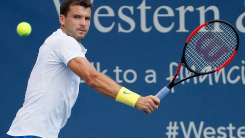 Gregor Dimitrov, of Bulgaria, returns to Feliciano Lopez, of Spain, during the middle rounds at the Western & Southern Open tennis tournament, Wednesday, Aug. 16, 2017, in Mason, Ohio. (AP Photo/John Minchillo)