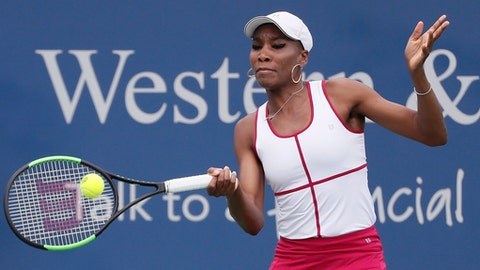 Venus Williams returns to Ashleigh Barty, of Australia, during the middle rounds at the Western & Southern Open tennis tournament, Wednesday, Aug. 16, 2017, in Mason, Ohio. (AP Photo/John Minchillo)