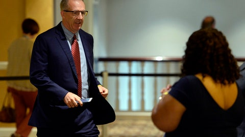 Southeastern Conference Commissioner Greg Sankey, head of the NCAA infraction panel handling North Carolina's ongoing academic case, walks to the conference room after taking a break during an NCAA hearing Wednesday, Aug. 16, 2017, in Nashville, Tenn. It has taken more than two years for North Carolina to appear before an NCAA infractions committee panel since initially being charged with five top-level violations amid its long-running academic scandal. (AP Photo/Mark Zaleski)