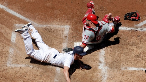 San Diego Padres' Wil Myers, left, steals home, sliding in under the late tag by the Philadelphia Phillies catcher Cameron Rupp during the fourth inning of a baseball game Wednesday, Aug. 16, 2017, in San Diego. (AP Photo/Gregory Bull)