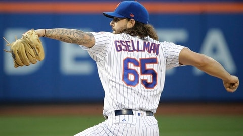 New York Mets' Robert Gsellman (65) delivers a pitch during the first inning of a baseball game against the New York Yankees Wednesday, Aug. 16, 2017, in New York. (AP Photo/Frank Franklin II)