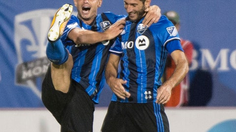Montreal Impact's Blerim Dzemaili, left, congratulates Ignacio Piatti on his second goal of the night against the Chicago Fire, during the first half of an MLS soccer match Wednesday, Aug. 16, 2017, in Montreal. (Paul Chiasson/The Canadian Press via AP)