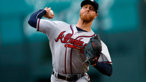 Atlanta Braves starting pitcher Mike Foltynewicz throws to a Colorado Rockies batter during the first inning of a baseball game Wednesday, Aug. 16, 2017, in Denver. (AP Photo/David Zalubowski)
