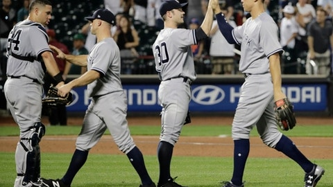 New York Yankees' Aaron Judge, right, celebrates with teammates David Robertson (30), Brett Gardner (11) and Gary Sanchez (24) after a baseball game against the New York Mets Wednesday, Aug. 16, 2017, in New York. The Yankees won 5-3. (AP Photo/Frank Franklin II)
