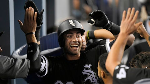 Chicago White Sox's Nicky Delmonico is congratulated by teammates after hitting a solo home run during the fourth inning of a baseball game against the Los Angeles Dodgers, Wednesday, Aug. 16, 2017, in Los Angeles. (AP Photo/Mark J. Terrill)