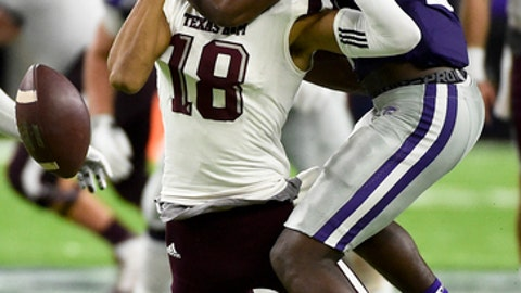 FILE - In this Dec. 28, 2016, file photo, Kansas State defensive back D.J. Reed, right, breaks up a pass intended for Texas A&M wide receiver Edward Pope (18) during the second half of the Texas Bowl NCAA college football game, in Houston. The school that once produced Chris Canty and Thorpe Award winner Terence Newman has struggled to defend the pass in recent years, though that's hardly an unconscionable sin in the pass-happy Big 12. Kansas State returns Reed and running mate Duke Shelley and the Wildcats harbor hope that things will be different this season. (AP Photo/Eric Christian Smith, File)