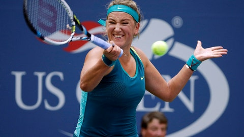 """FILE - In this Sept. 3, 2015, file photo, Victoria Azarenka, of Belarus, returns a shot to Yanina Wickmayer, of Belgium, during the second round of the U.S. Open tennis tournament, in New York. Two-time Australian Open champion Victoria Azarenka says her participation in the U.S. Open is in doubt because she might not be able to bring her baby son with her to New York as a result of her separation from the child's father. Azarenka says via a posting on Twitter on Thursday, Aug. 17, 2017, that she is """"faced with a difficult situation which may not allow me to return to work right away."""" (AP Photo/Charles Krupa, File)"""