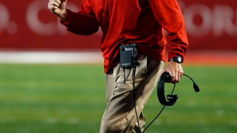 FILE - In this Nov. 5, 2016, file photo, New Mexico coach Bob Davie celebrates a touchdown scored by quarterback Austin Apodaca during the second half of an NCAA college football game against Nevada, in Albuquerque, N.M. New Mexico is looking to keep pushing forward coming off a 9-4 season and after consecutive bowls appearances, including the program's first postseason win since 2007. (AP Photo/Andres Leighton, File)
