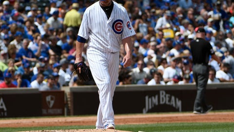 Chicago Cubs starting pitcher Jon Lester (34) reacts after giving up eight runs to the Cincinnati Reds during the second inning of a baseball game, Thursday, Aug. 17, 2017, in Chicago. (AP Photo/David Banks)
