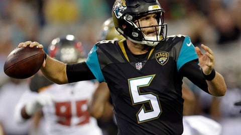 Jacksonville Jaguars quarterback Blake Bortles (5) throws a pass for a first down against the Tampa Bay Buccaneers during the first half of an NFL preseason football game, Thursday, Aug. 17, 2017, in Jacksonville, Fla. (AP Photo/John Raoux)