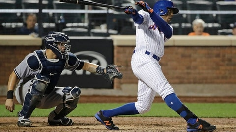 New York Mets' Curtis Granderson follows through on a grand slam during the ninth inning of a baseball game against the New York Yankees on Thursday, Aug. 17, 2017, in New York. The Yankees won 7-5. (AP Photo/Frank Franklin II)