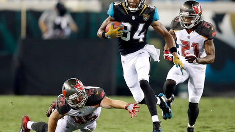 Jacksonville Jaguars' Keelan Cole (84) gets past Tampa Bay Buccaneers' Alan Cross (45) and Justin Evans (21) during the first half of an NFL preseason football game, Thursday, Aug. 17, 2017, in Jacksonville, Fla. (AP Photo/Stephen B. Morton)