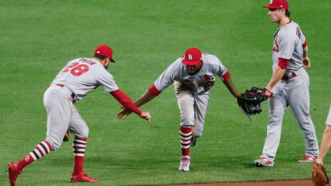St. Louis Cardinals center fielder Dexter Fowler, center, celebrates with left fielder Tommy Pham (28) and right fielder Randal Grichuk after the Cardinals defeated the Pittsburgh Pirates 11-7 in a baseball game, early Friday, Aug. 18, 2017, in Pittsburgh. (AP Photo/Keith Srakocic)