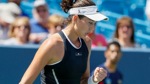 Garbine Muguruza, of Spain, reacts during a match against Svetlana Kuznetsova, of Russia, at the Western & Southern Open tennis tournament, Friday, Aug. 18, 2017, in Mason, Ohio. (AP Photo/John Minchillo)